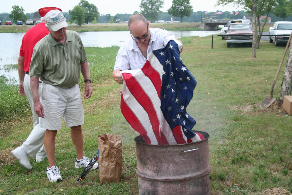 Bill Page & Steve Hinton prepare a flag for retirement